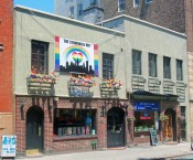 Stonewall_Inn_2012_with_gay-pride_flags_and_banner