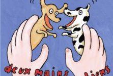 Deux mains deux petits chiens de Nadja